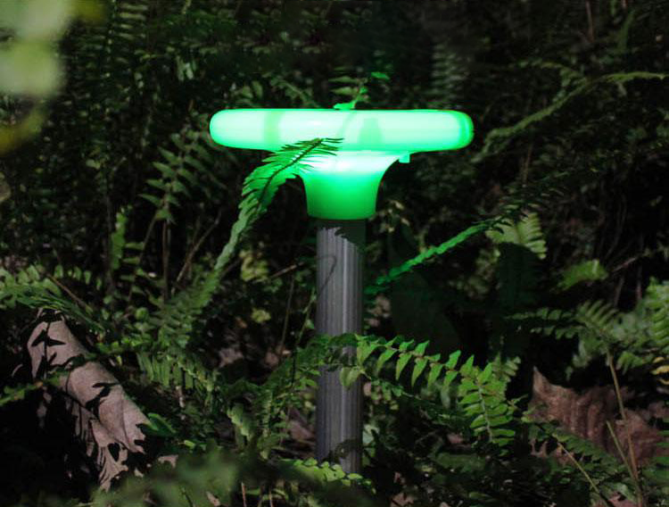 Mole repellent with decorative LED lamp